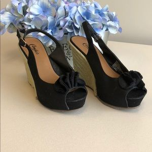 Candie's black sling back wedge